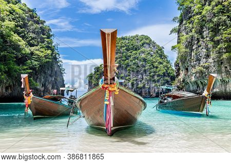 Thai Traditional Wooden Longtail Boat And Beautiful Beach In Phuket Province, Thailand.