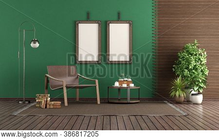 Fashionable Leather Armchair In A Green Living Room, With Blank Picture Frame And Wooden Panel - 3d
