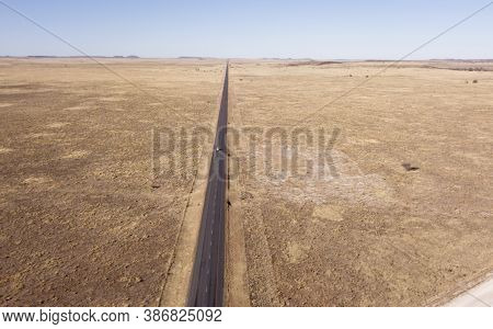 Aerial Of Long Straight Road In Flat Landscape