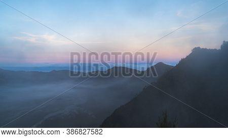 Beautiful Sunrise At Mt. Bromo Gurung In Indonesia, Pink Blue Purple Dusk, Morning Light Smog, Fog I
