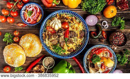 Uzbek And Central Asia Cuisine Concept. Assorted Uzbek Food Pilaf Samsa Manti Or Manty, Shurpa Uzbek