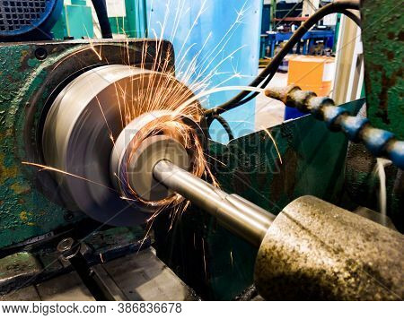 Grinding The Hole With An Abrasive Stone On A Circular Grinding Machine