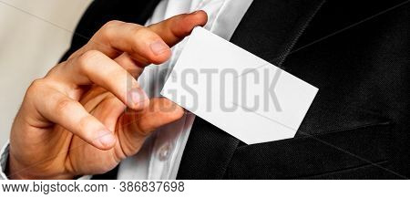 Part Of Body Of Man Who Takes Out Business Card From The Pocket Of Business Suit, Copyspace. Busines