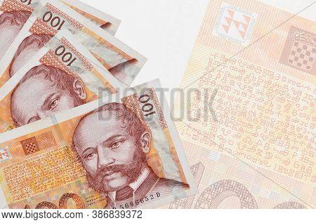 100 Croatian Kuna Bills Lies In Stack On Background Of Big Semi-transparent Banknote. Abstract Busin