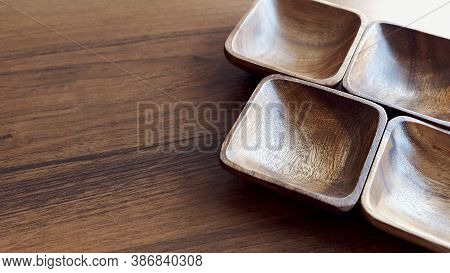Wooden Utensils For The Kitchen, Bowls, Plates On A Wooden Table. The Concept Of Natural Dishes, A H
