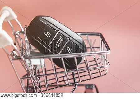 Keys To The Car In Supermarket Trolley. The Concept Of Buying A Car, Increasing The Cost Of Cars