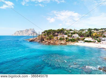 Turquoise Bay Of Mediterranean Sea Of Benissa Spanish Resort Town. White Sand On The Beach, Hillside