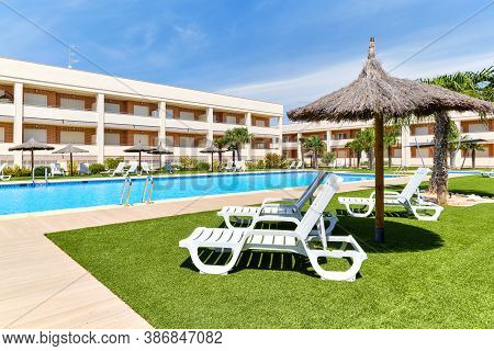 Torrevieja, Spain - June 2, 2020: Empty Area With Deckchairs And Swimming Pool During Sunny Summer D