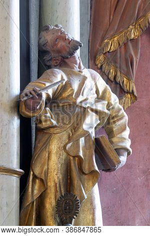 KRAPINA, CROATIA - JULY 01, 2013: Saint Luke statue on the altar of the Parting of the Apostles at the Church of Our Lady of Jerusalem at Trski Vrh in Krapina, Croatia