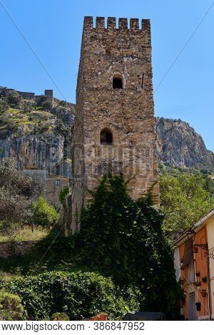 Famous Historic Buildings Castle Tower View Against Blue Sky Located On Hill Above The Town Of Xativ