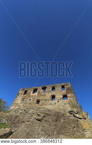 Ruined Frontage Of The Medieval Palace With Deep Blue Sky Above