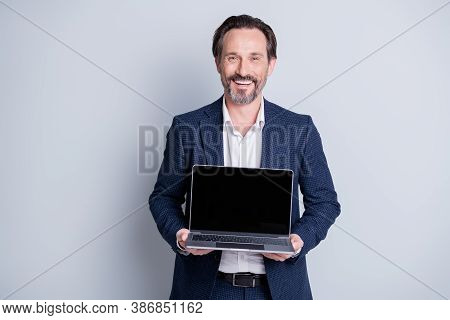 Photo Of Confident Cheerful Aged Mature Business Guy Hold Computer Netbook Notebook Showing Customer
