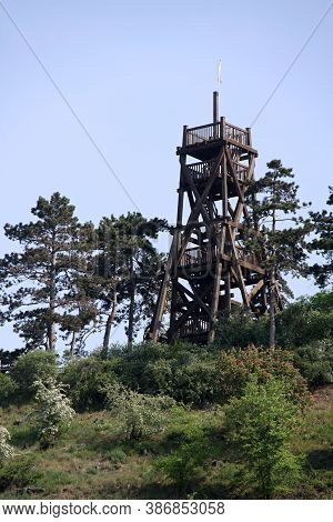 Wooden Outlook Tower Above The Trees On The Top Of The Hill