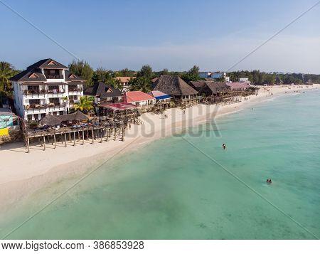 Top Aerial View On The Beautiful White Sand Ocean Coast In Nungwi At Zanzibar Island, Tanzania