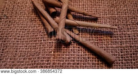 Indian Traditional Bidi Made With Dry Leaf, Cigarette On Brown Sack Mat Background, Pack Of Cigarett