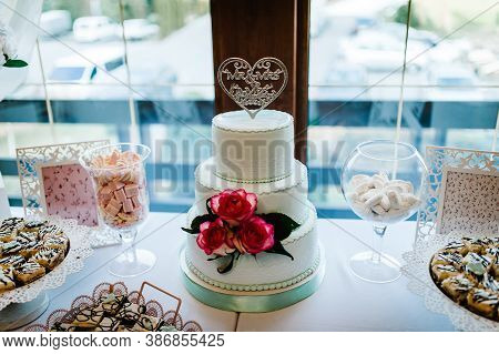 Dessert Table For A Party. Cakes, Pie, Cupcakes. Colorful Table With Sweets And Goodies For The Wedd