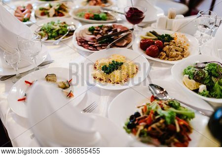Wedding Table, Food, Drinks, Water. Table With Silver And Glass Stemware At Restaurant Before Starti
