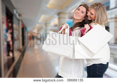 Two young women in a happy shopping expedition