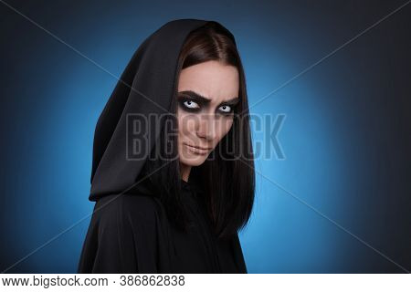 Mysterious Witch With Spooky Eyes On Color Background, Space For Text