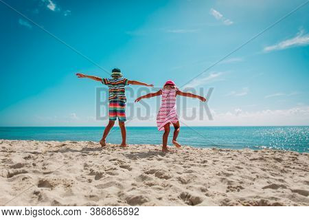 Happy Boy And Girl Play Dance At Beach