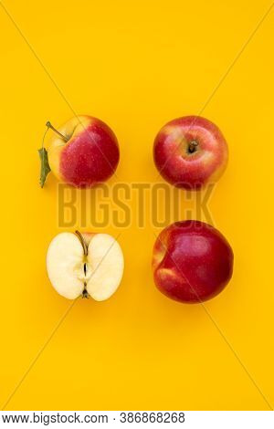 Fresh Red Gala Apples On Yellow Background. Top View. Flat Lay