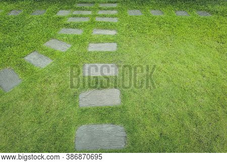 Walkway Sheet Stretching Into The Distance With Green Grass Lawn In Perspective View In Garden. Gard