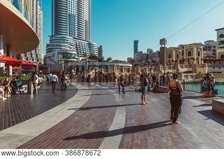 Dubai, Uae - December 12, 2018: Tourists And Local People Near Mall Of Dubai. Tourist Attracting Bur