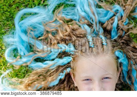 Portrait Of Beautiful Girl With Many Braids With Blue Kanekalon.cute Girl 7 Years Old With Braids On