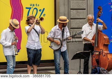 Florence, Italy - Aug 3, 2020: Four Unidentified Street Musicians, Play Their Instrument, Banjo, Tru