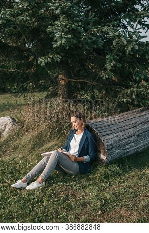 Woman Working Writing Notes Outdoor. Distant Remote Work Job. Young Middle Age Female Student Outdoo
