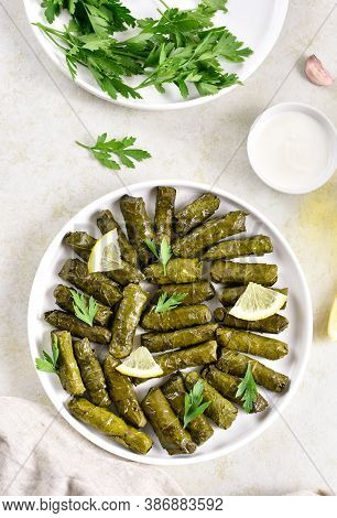 Dolma, Stuffed Grape Leaves With Rice And Meat On Light Stone Background. Top View, Flat Lay