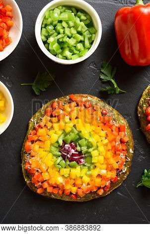 Rainbow Veggie Bell Peppers Pizza On Black Stone Background. Vegetarian Vegan Or Healthy Food Concep