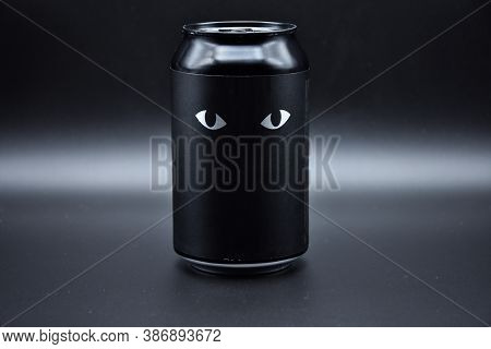 Two Drawn Eyes On A Black Background. Two Cat Eyes Drawn On A Black Background On An Aluminum Can