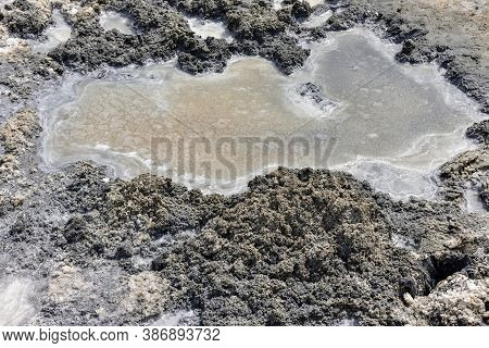 Crystallized Salt And Natural Mineral Mud In A Dried Salt Lake. Here People Take Mud Baths Because O