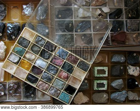 A Collection Of Rock And Mineral Samples For Working In Geology Is In Plastic Boxes