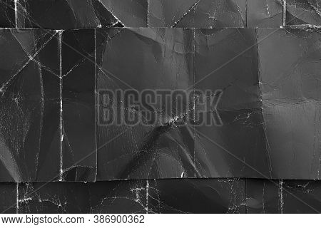 Grunge Texture Of Black Crumpled Paper With A Cut Stripe Superimposed On Top Close-up. For Dark Desi