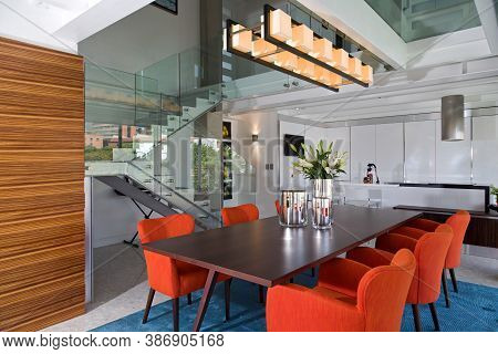 Modern And Bright Dining Room Of Luxurious Apartment. Interior Design And Decoration, Dark Wood Tabl