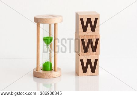 Close-up Of An Hourglass Next To Wooden Blocks With The Text Www