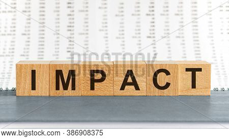 Impact Word Written On Wood Block. Impact Text On Table, Concept.
