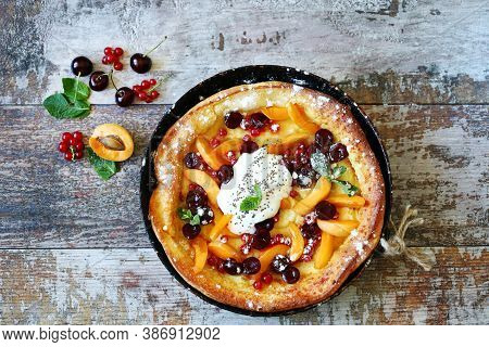 Delicious Dutch Baby Pancake With Fruit And Ice Cream.