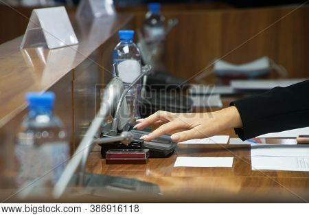 Hand Of A Woman Voting During A Political Meeting. Parliamentary Lawmaking. Without A Face.. Shallow
