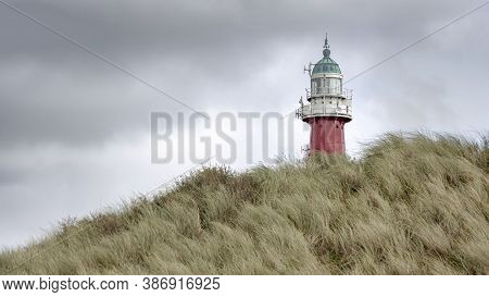 The Lighthouse Of Scheveningen Near The City Of The Hague In The Netherlands. The Foreground Shows A