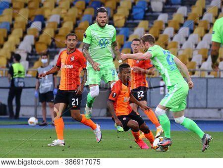 Kyiv, Ukraine - August 5, 2020: Shakhtar Donetsk (in Orange) And Vfl Wolfsburg (in Green) Players Fi