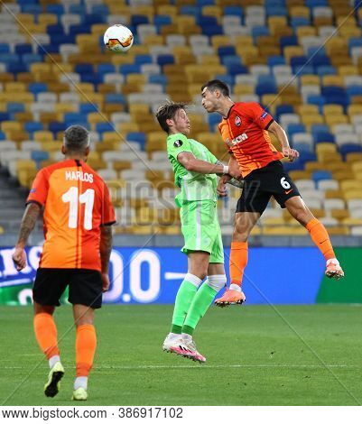 Kyiv, Ukraine - August 5, 2020: Taras Stepanenko Of Shakhtar Donetsk (r) Fights For A Ball With Wout