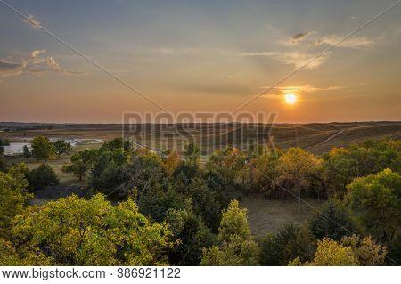 sunset over Nebraska Sandhills at Nebraska National Forest, aerial view of early fall scenery