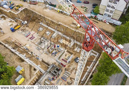 Tower Crane And Construction Machinery On Construction Site Of New Building. Aerial View From Flying