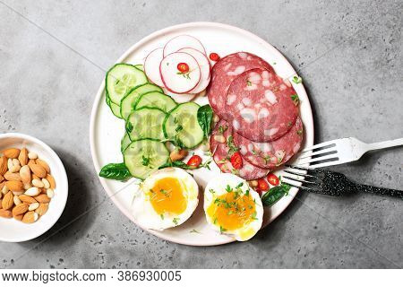 Breakfast, Snack, Ketogenic Food. Sausage, Salami, Egg, Cucumber, Lettuce, Delicious Plate For A Sna
