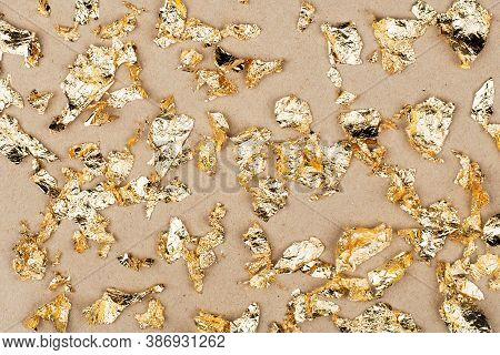 Gold Luxury Wealth Holiday Background. Gold Foil Flakes, Patal, On The Background. View From Above.
