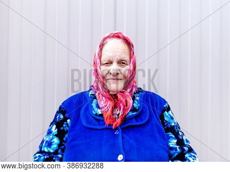 Portrait Of An Old Grandmother In A Scarf