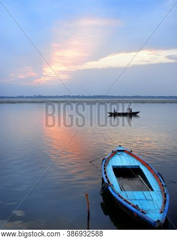 A Boat On The River Ganges At Varanasi On Sunrise.
